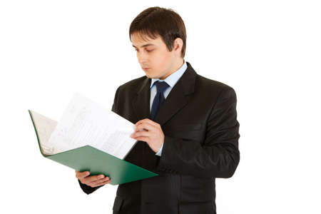 centrality: Concentrated modern businessman holding folder and checking documents isolated on white  Stock Photo