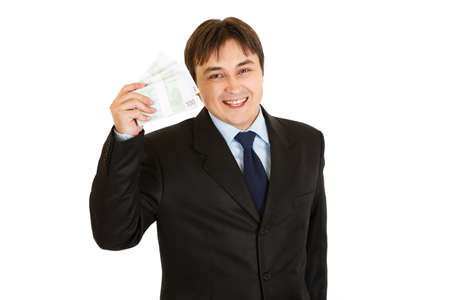 batch of euro: Smiling modern businessman holding euro packs in his hand isolated on white