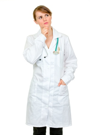 Thoughtful medical doctor woman looking  up at copy space isolated on white Stock Photo - 9247056