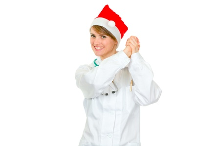 heal new year: Smiling female medical doctor in Santa hat showing partnership gesture isolated on white