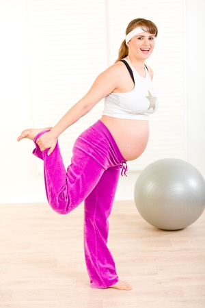 Smiling attractive pregnant woman making gymnastics  at home Stock Photo - 9303045