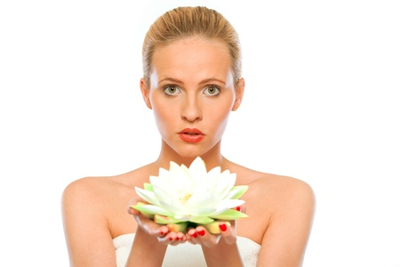 nenuphar: Young beautiful woman holding lotus flower in hands  isolated on white  Stock Photo