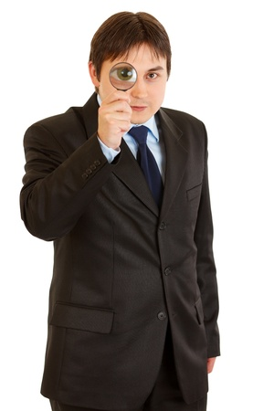 interrogatively: Interested modern businessman looking through magnifying glass isolated on white