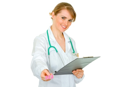 Smiling medical doctor woman holding clipboard and prescription drugs in hands  isolated on white Stock Photo - 9465733