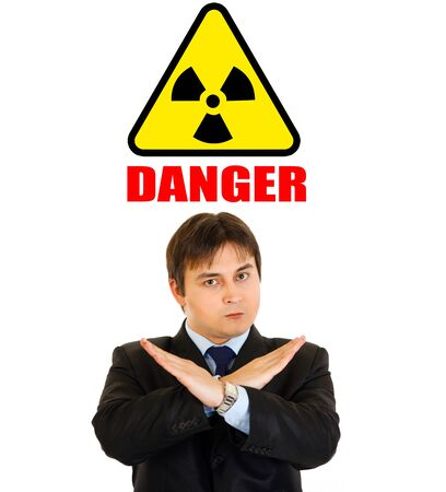 Сoncept-radiationdanger! Confident businessman with crossed arms isolated on white  photo