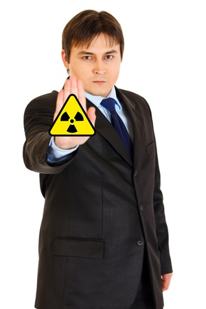 Сoncept-radiation hazard! Confident modern businessman showing stop gesture isolated on white