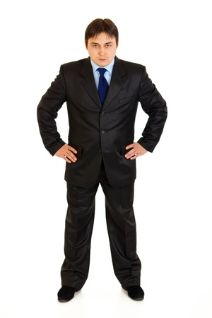 stringent: Full length portrait of strict businessman with hands on hips attentively looking at you isolated on white  Stock Photo