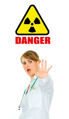 Concept-radiation hazard! Scared young medical female doctor isolated on white Stock Photo - 9515427