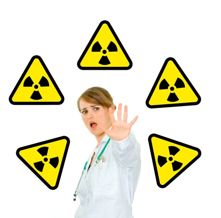 Concept-radiation hazard! Scared young medical female doctor isolated on white  photo