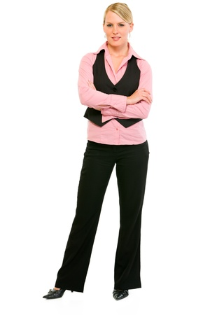 Full length portrait of smiling business woman with crossed arms on chest isolated on white Stock Photo - 9556797