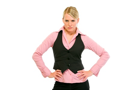 authoritative: Authoritative modern business woman with hands on hips isolated on white  Stock Photo