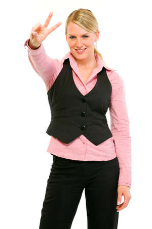 Smiling modern business woman showing victory gesture isolated on white Stock Photo - 9558027