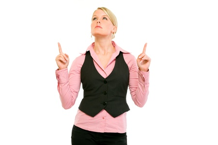 interested: Interested modern business woman pointing up in copy space isolated on white