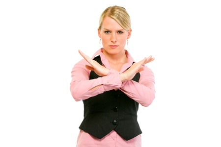 authoritative: Authoritative modern business woman with crossed arms isolated on white. Forbidden gesture
