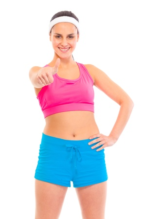 Smiling young confident girl in sportswear showing thumbs up gesture isolated on white Stock Photo - 9617024