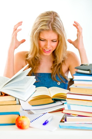 stressful: Frustrated teengirl with lots of books tired of studying  Stock Photo