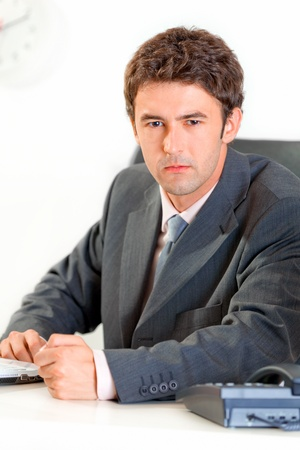 banging: Angry modern business man banging fist on table  Stock Photo