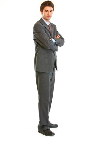 certitude: Full length portrait of serious businessman with crossed arms on chest isolated on white