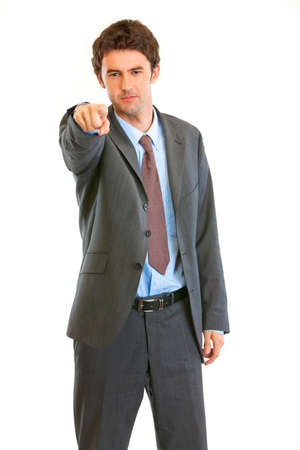 certitude: Serious modern businessman pointing finger at you isolated on white  Stock Photo