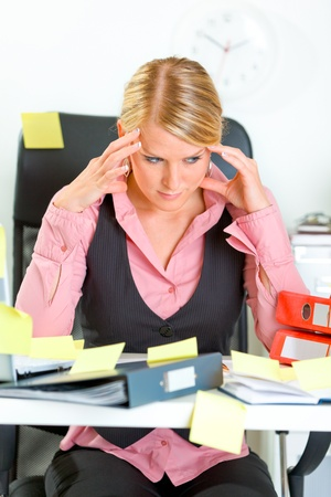 Tired modern business woman sitting at workplace overwhelmed with sticky reminder notes Stock Photo - 9665736