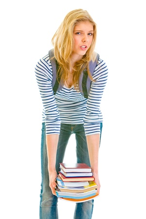 Shocked teen girl holding heavy pile of books in hands isolated on white Stock Photo - 9665609