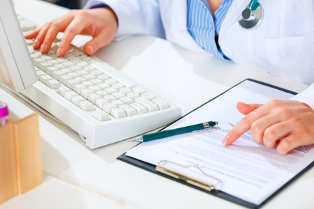 Medical doctor woman working at office table. Closeup.
