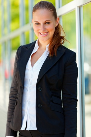 Portrait of smiling  modern business woman  at office building   photo