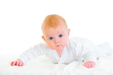 interrogatively: Cute  four month old  baby girl laying on abdomen on diaper