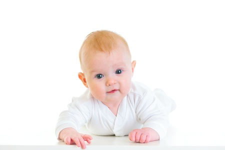 interrogatively: Smiling four month old  baby girl laying on abdomen  Stock Photo