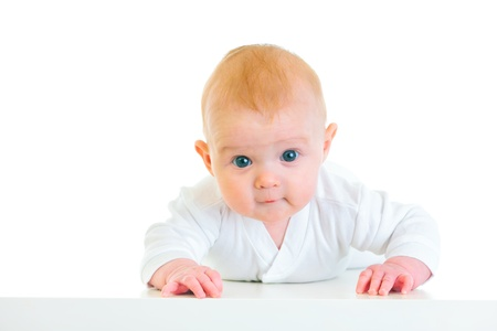 interested: Interested  four month old  baby girl laying on abdomen   Stock Photo