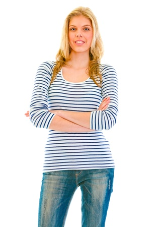 Smiling beautiful teen girl with crossed arms on chest isolated on white  photo