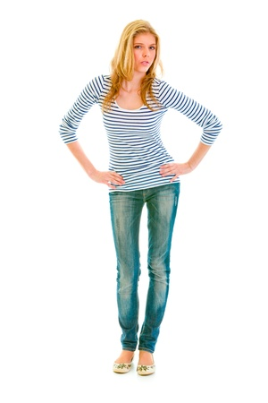 Full length portrait of beautiful teen girl with hands on hips attentively looking at you isolated on white Stock Photo - 9792790