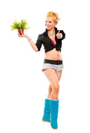 Full length portrait of young girl with flower in pot showing thumbs up gesture isolated on white Stock Photo - 9950934
