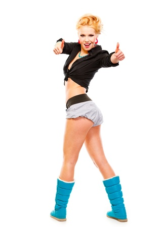 Full length portrait of cheerful young girl standing in half-turn showing thumbs up gesture isolated on white