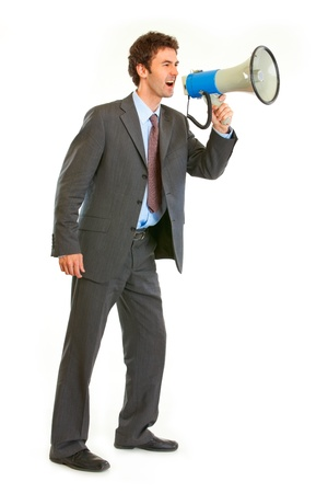 strenuous: Full length portrait of frustrated modern businessman yelling through megaphone isolated on white  Stock Photo