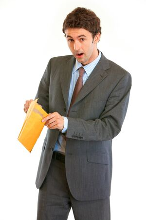 Shocked modern businessman checking parcel isolated on white  photo