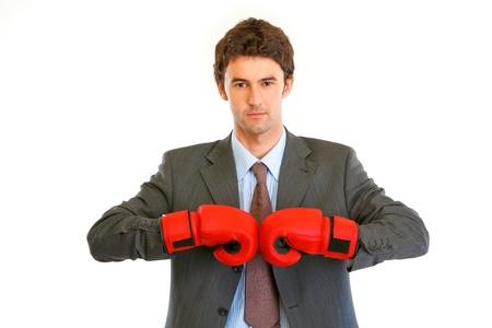 authoritative: Authoritative modern businessman with boxing gloves isolated on white