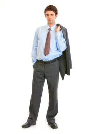 certitude: Full length portrait of confident businessman with jacket on his shoulder isolated on white  Stock Photo