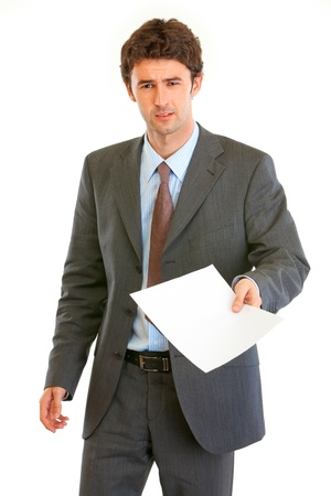 displeased businessman: Displeased modern businessman showing document  isolated on white