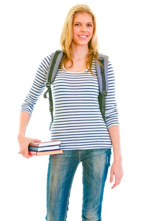 classbook: Cheerful teengirl with schoolbag holding books in hand isolated on white   Stock Photo