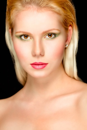 Portrait of young beautiful blond hair girl. Retouched photo
