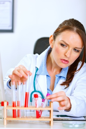 sagacious: Doctor woman working with tubes in laboratory  Stock Photo