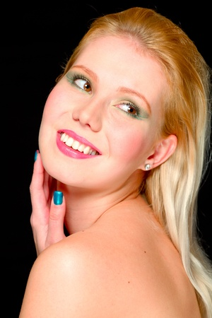 Portrait of blond hair beautiful young girl looking in corner photo