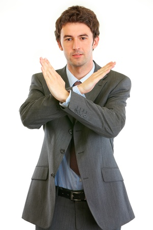 certitude: Confident businessman with crossed arms  isolated on white. Forbidden gesture