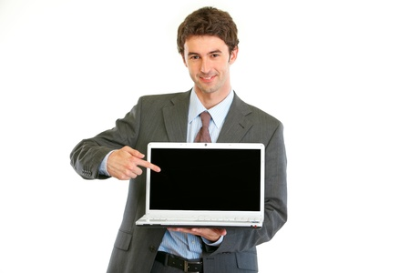 Modern businessman pointing on laptops blank screen isolated on white  photo