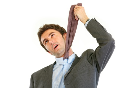 uptight: Stressed businessman hanging himself on his necktie isolated on white