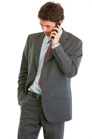 centrality: Concerned businessman talking on phone isolated on white  Stock Photo
