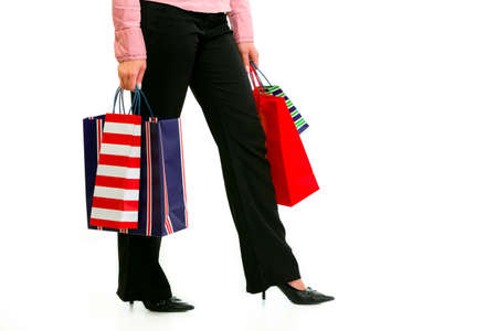 Closeup on legs and hands with shopping bags isolated on white