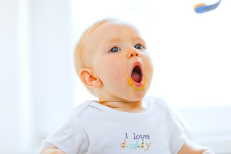baby chair: Eat smeared lovely baby girl open mouth for spoon