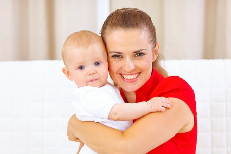 parents baby: Portrait of lovely baby and young mother  Stock Photo